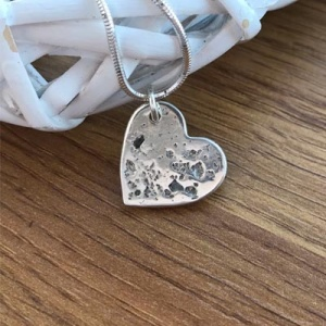 Handmade pure silver charm with ashes