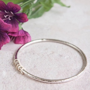 MILESTONE SILVER BANGLE WITH GOLD RINGS