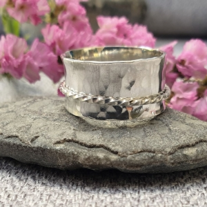 Silver spinner ring with hammered finish and twisted silver spinning band