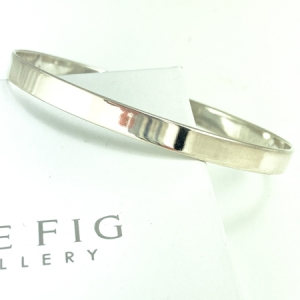 Sterling silver bangle - oval shaped - wide - polished