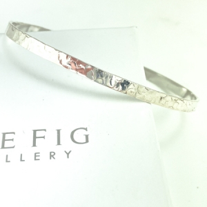 Sterling silver bangle - oval shaped - narrow - hammered texture