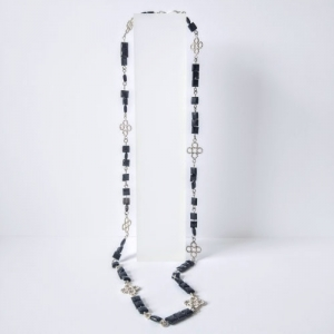 Silver and Black Onyx Beaded Quatrefoil Matinee Necklace - silver and black necklace on stand against light grey background